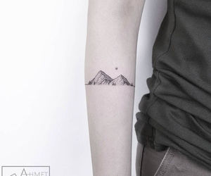mountains and tattoo image