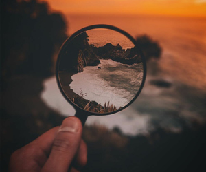 magnifying glass, shore, and sunset image