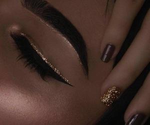 eyebrows, eyeliner, and glitter image