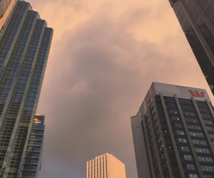 city, buildings, and clouds image