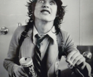 angus young, ac dc, and black and white image