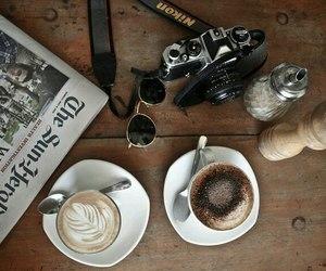 coffee, camera, and newspaper image