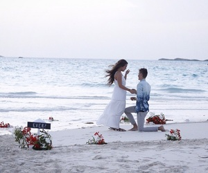 beach, engagement, and flowers image