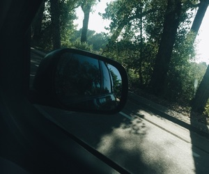 car, car mirror, and car window image