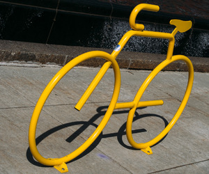 bicycle, sculpture, and yellow image
