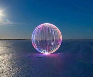 ball, ocean, and lazers image
