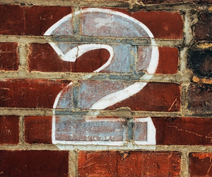 brick wall, maroon, and numbers image