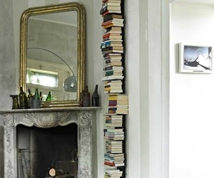 book, fireplace, and mirror image