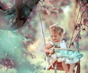 girl, baby, and swing image