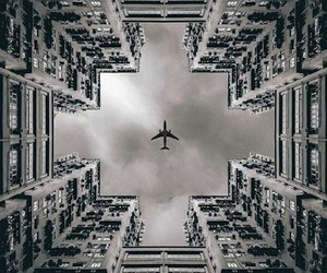 airplane, building, and black and white image