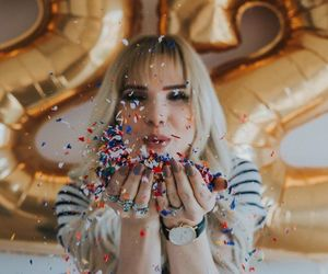 girl, 22, and balloons image