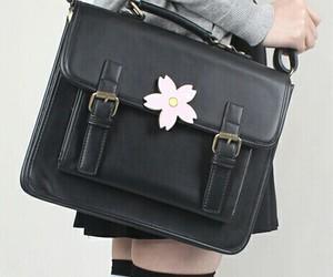 backpack, brooch, and pink rose image