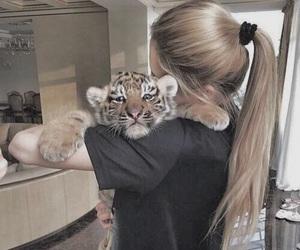 girl, tiger, and hair image