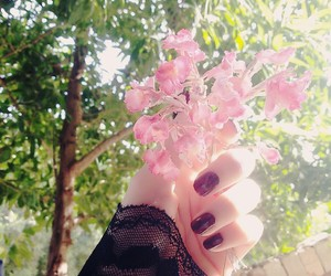 black, flowers, and hand image