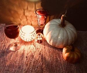 candle, pumpkin, and samhain image