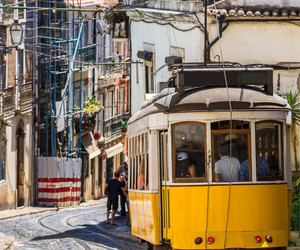 city, tram, and lisbon image