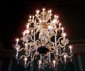 chandelier, candle, and ceiling image