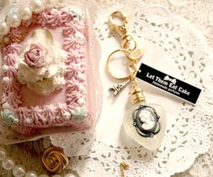 baubles, doily, and eiffel tower image