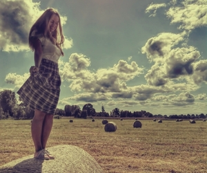 clouds, girl, and hay image