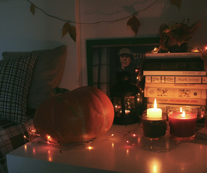 book, candle, and pumpkin image