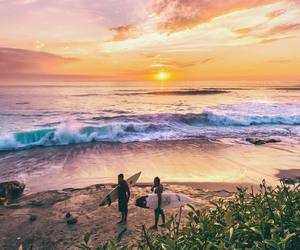 beach, sunset, and surfer image