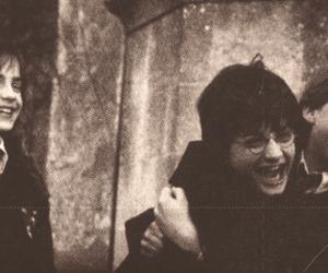 Daniel Radcliff, rupert grint, and emma watson image