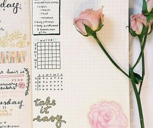 journal and rose image