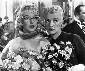 Marilyn Monroe, Betty Grable, and vintage image