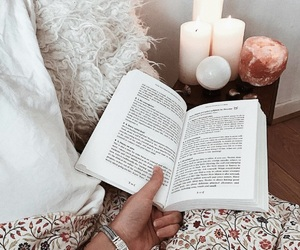 bed, book, and candles image