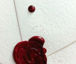Letter, red, and white image