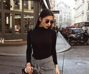 black sweater, grey skirt, and plaid skirt image