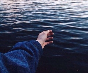 hand, sea, and blue image