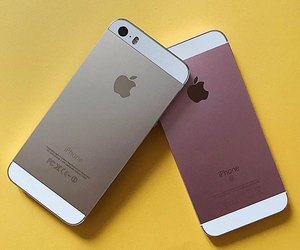 apple, cellular, and gold image