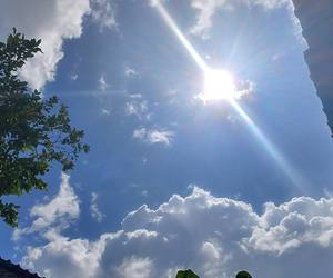blue sky, clouds, and sun image
