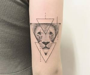 arm tattoo, triangle tattoo, and animal tattoo image