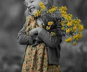 baby, yellow, and flowers image