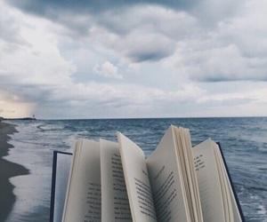 book, sea, and beach image