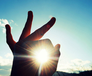 hand, sunshine, and sky image