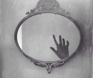 hand, mirror, and black image
