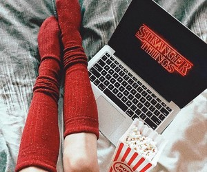 stranger things, red knee high socks, and yummy popcorn image