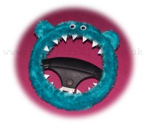 googly eyes, steering wheel cover, and teal image