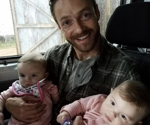 aaron, negan, and ross marquand image