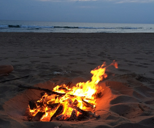 fire, night, and sea image