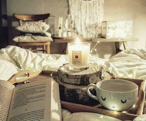 books, candles, and chilling image