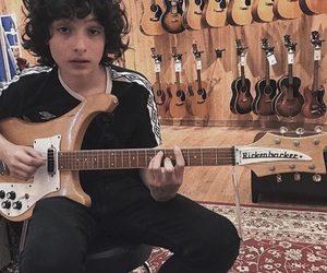 finn wolfhard and guitar image
