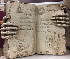 book, potions, and skeleton image