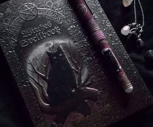 black cat, book, and charms image