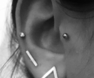 ear ring, lobe, and piercing image