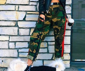 black leather jacket, white crop tops, and camo pants image