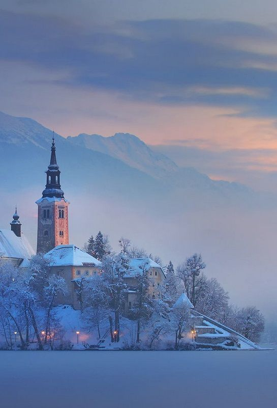 Mystical Winter Morning At Lake Bled Surrounded By The Alps